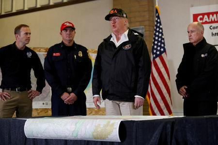 FILE PHOTO: U.S. President Donald Trump speaks during a briefing with State officials after visiting the charred wreckage of Skyway Villa Mobile Home and RV Park in Paradise,oucin Chico, California, Nov. 17, 2018. REUTERS/Leah Millis/File Photo