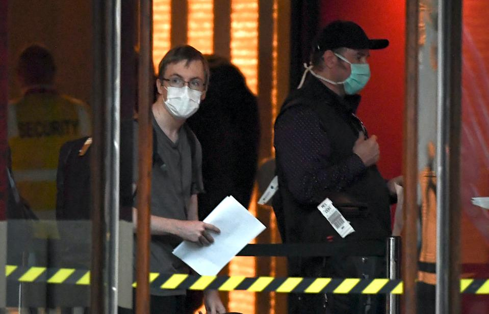 A traveller returned from overseas is checked into an inner-city hotel in Melbourne on March 30. Source: Getty
