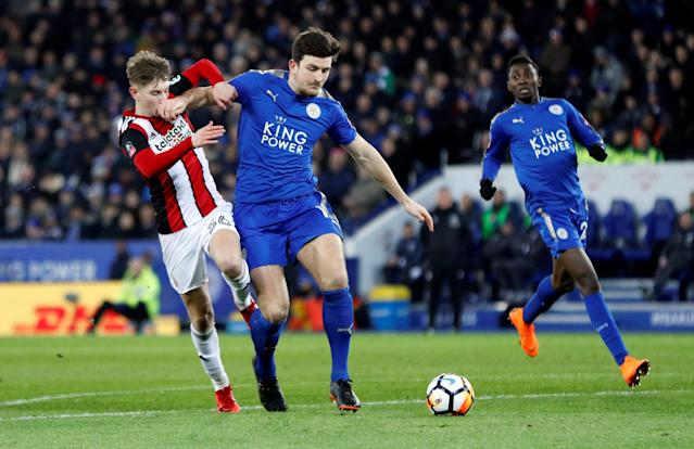 Soccer Football - FA Cup Fifth Round - Leicester City vs Sheffield United - King Power Stadium, Leicester, Britain - February 16, 2018 Leicester City's Harry Maguire in action with Sheffield United's David Brooks REUTERS/Darren Staples