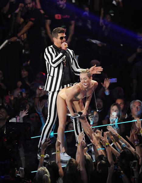 Robin Thicke, left, and Miley Cyrus perform at the MTV Video Music Awards on Sunday, Aug. 25, 2013, at the Barclays Center in the Brooklyn borough of New York. (Photo by Scott Gries/Invision/AP)