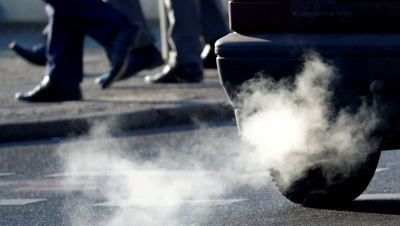 FILE PHOTO: An exhaust pipe of a car is pictured on a street in a Berlin