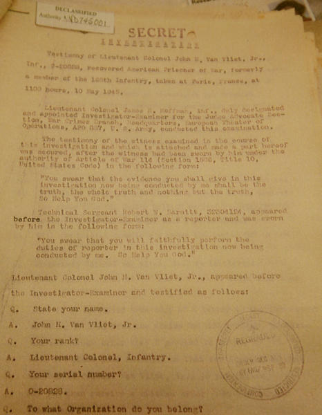 This picture taken in Warsaw, Poland, on Wednesday, Jan. 8, 2014, shows a copy of the first page of what is believed recently uncovered vital testimony made in 1945 in Paris by U.S. Lt. Col. John H. Van Vliet Jr. It provides evidence of Soviet responsibility for the World War II massacre of some 22,000 Polish officers in Katyn forest and other locations in then-Soviet Union. Researcher Krystyna Piorkowska says she found it in November in archives near Washington, among wartime documents of the U.S. Embassy in Paris. (AP Photo/Czarek Sokolowski)
