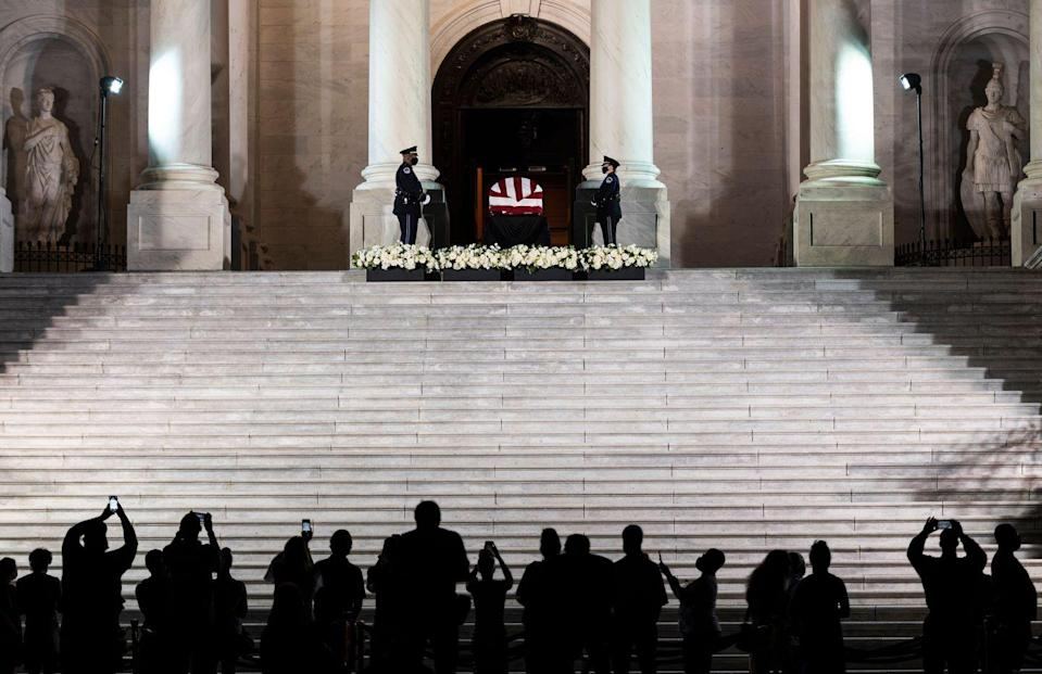 <p>As night fell, individuals gathered to pay their respects and mourn the Civil Rights icon. </p>