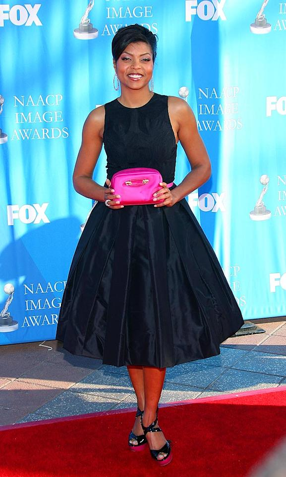 """Taraji Henson channels classic Hollywood with an upswept 'do, simple black dress, and tiny pink purse. Maury Phillips/<a href=""""http://www.wireimage.com"""" target=""""new"""">WireImage.com</a> - February 14, 2008"""