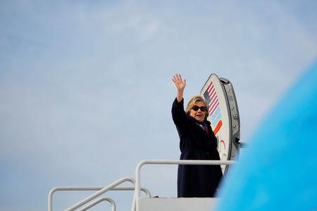 U.S. Democratic presidential nominee Hillary Clinton boards her campaign plane in White Plains, New York, U.S. October 29, 2016.  REUTERS/Brian Snyder