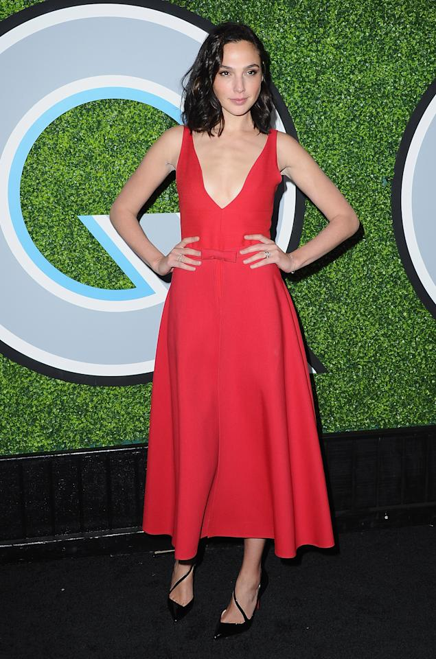 <p>The brunette A-lister, known for playing Woman Woman, opted for a plunging red dress and strappy black heels.<em> [Photo: Getty]</em> </p>