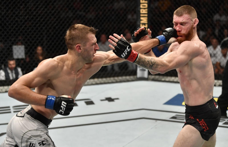 AUCKLAND, NEW ZEALAND - FEBRUARY 23: (L-R) Dan Hooker of New Zealand punches Paul Felder in their lightweight during the UFC Fight Night event at Spark Arena on February 23, 2020 in Auckland, New Zealand. (Photo by Jeff Bottari/Zuffa LLC)