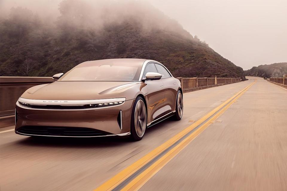 The Lucid Air electric car driving across a bridge in foggy conditions. The Lucid Air Dream Edition Range got official EPA range in September 2021.