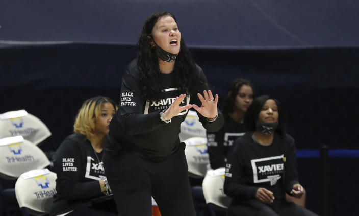 Xavier head coach Melanie Moore gives instructions during the first half of an NCAA college basketball game against Connecticut, Saturday, Feb. 20, 2021, in Cincinnati. (AP Photo/Gary Landers)