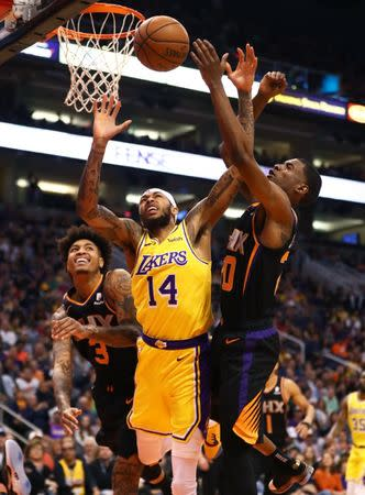 FILE PHOTO: Mar 2, 2019; Phoenix, AZ, USA; Los Angeles Lakers forward Brandon Ingram (14) battles for a loose ball against Phoenix Suns forward Josh Jackson (20) and forward Kelly Oubre Jr. (3) in the first half at Talking Stick Resort Arena. Mandatory Credit: Mark J. Rebilas-USA TODAY Sports