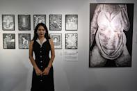'Cracks' says her pseudonym springs from her artwork, which she views as opening a crack to 'let light in' to her life (AFP/Hector RETAMAL)