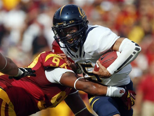 California quarterback Zach Maynard, right, is sacked by Southern California defensive end Leonard Williams during the first half of an NCAA college football game in Los Angeles, Saturday, Sept. 22, 2012. (AP Photo/Jae C. Hong)