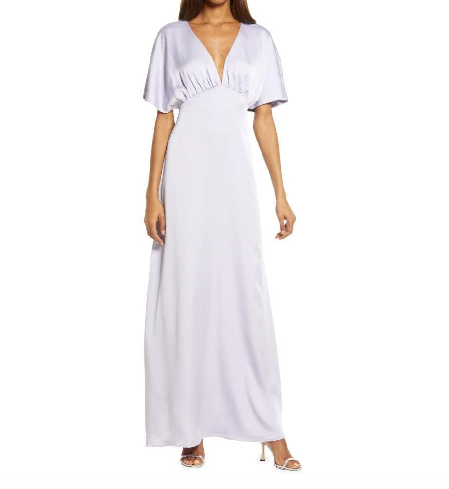 """We love a flutter sleeve, especially when it's lavender and under $200. $148, Nordstrom. <a href=""""https://www.nordstrom.com/s/wayf-the-chiara-flutter-sleeve-satin-dress/5871361"""" rel=""""nofollow noopener"""" target=""""_blank"""" data-ylk=""""slk:Get it now!"""" class=""""link rapid-noclick-resp"""">Get it now!</a>"""