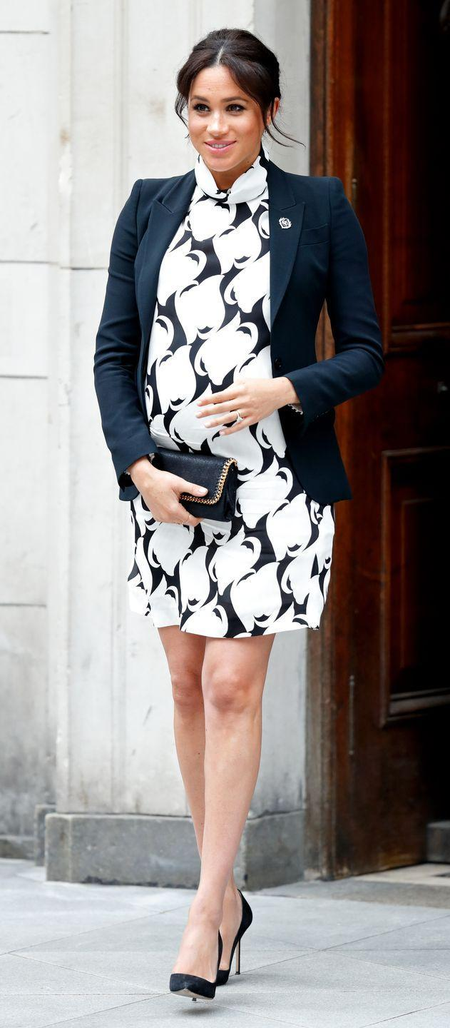 """<p>Meghan Markle looked polished at a panel for International Women's Day in 2019 in a black and white patterned shift dress and a simple black blazer. Still, <a href=""""https://www.thesun.co.uk/fabulous/8604099/meghan-markles-kate-inspired-dress-was-on-the-short-side-and-she-should-have-worn-tights-says-etiquette-expert/"""" rel=""""nofollow noopener"""" target=""""_blank"""" data-ylk=""""slk:the public was upset"""" class=""""link rapid-noclick-resp"""">the public was upset </a>over how high the hem came up on her knee and that she didn't wear tights to the event. </p>"""
