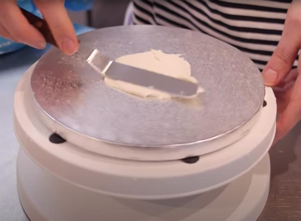 Frosting a cake plate on the bottom