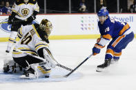 Boston Bruins goaltender Tuukka Rask (40) stops a shot on goal by New York Islanders' Anthony Beauvillier (18) during the second period of an NHL hockey game Saturday, Jan. 11, 2020, in New York. (AP Photo/Frank Franklin II)