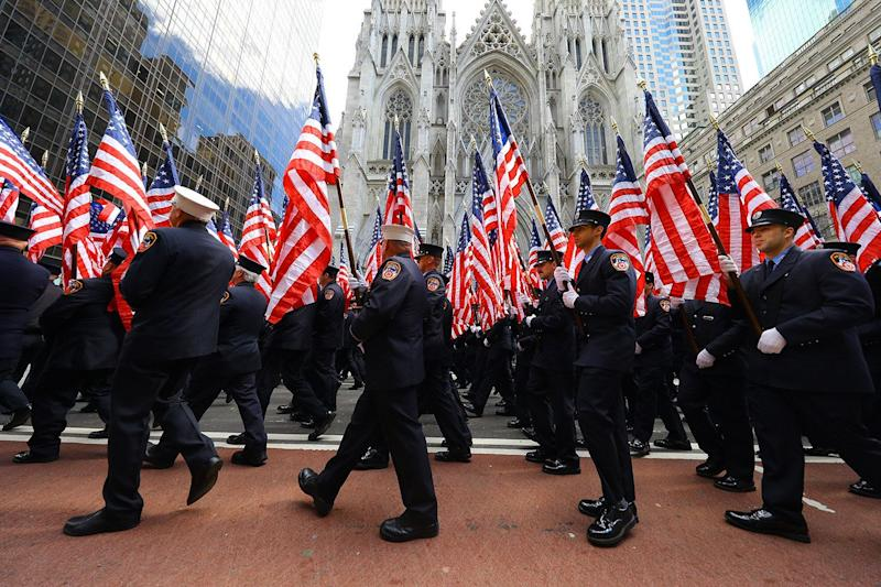 Members of the Fire Department Color Guard carry flags and march up Fifth Avenue during the St. Patrick's Day Parade in New York on March 16, 2019. (Photo: Gordon Donovan/Yahoo News)