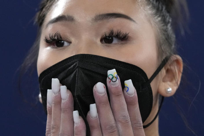 Sunisa Lee, of the United States, waits for the final results of the artistic gymnastics women's all-around final at the 2020 Summer Olympics, Thursday, July 29, 2021, in Tokyo. (AP Photo/Gregory Bull)