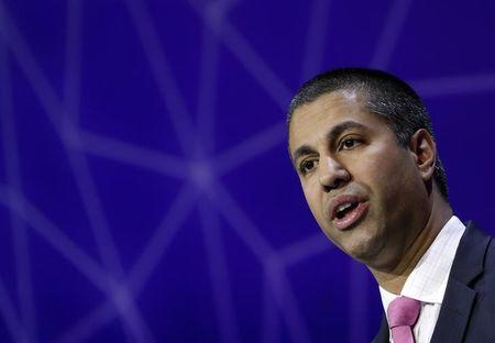 FILE PHOTO: Ajit Pai, Chairman of U.S Federal Communications Commission, delivers his keynote speech at Mobile World Congress in Barcelona