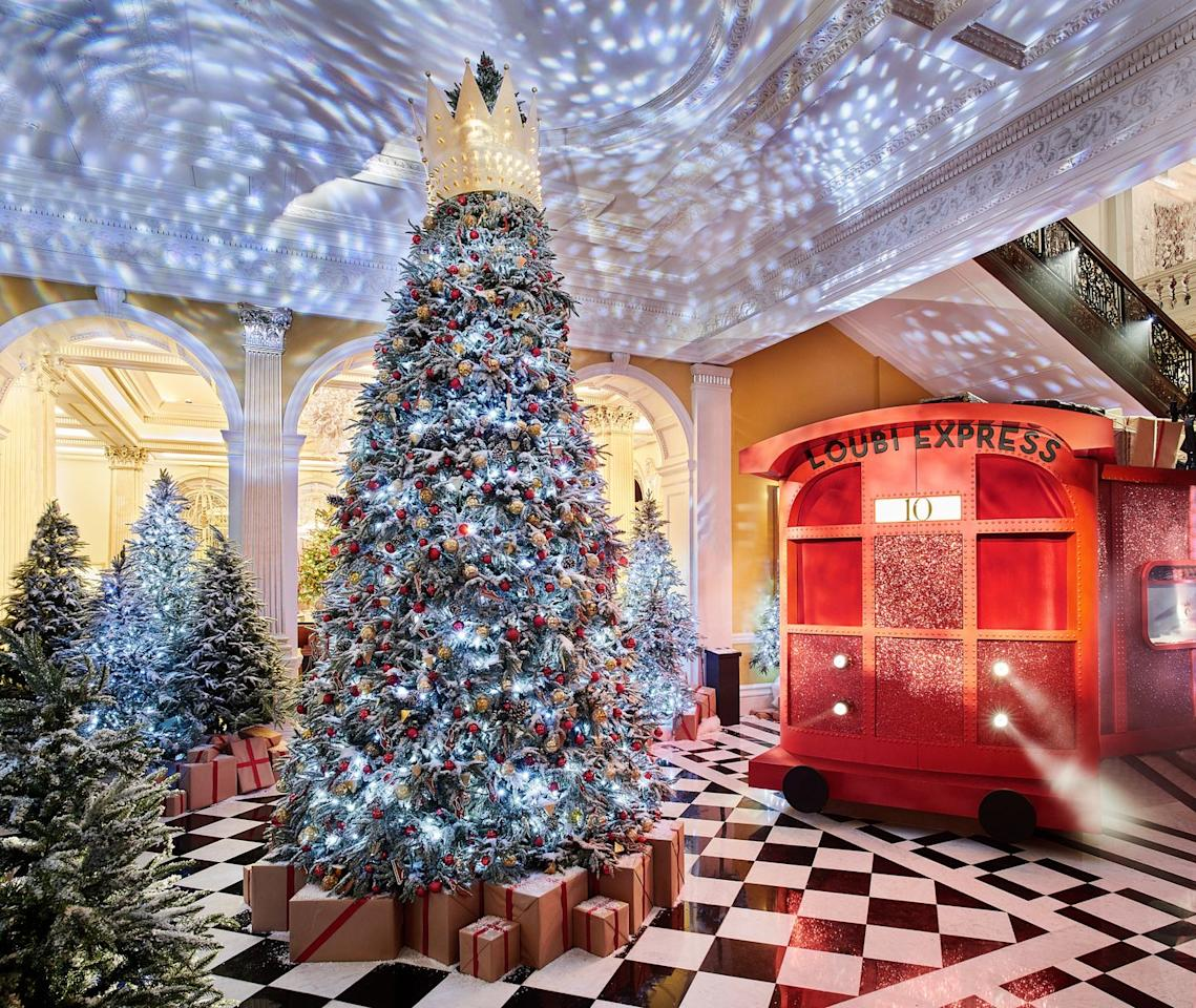 """<p>The 2019 Christmas tree at <a href=""""https://www.claridges.co.uk/"""" target=""""_blank"""">Claridge's in London</a> was decorated by  Christian Louboutin, which is why it features a very special <em>Loubi Express</em> holiday train in the display. Even better? You can actually enter the train—it has an intimate dining carriage with four tables inside and a cocktail conductor offering Champagne. </p>"""