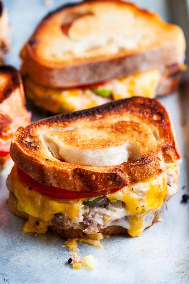 """<p>Ooey gooey and oh-so-cheesy, these sandwiches are comfort food at its finest-and easiest. You'll experience love at first bite.</p><p><strong>Get the recipe at <a href=""""https://www.aberdeenskitchen.com/2016/11/sheet-pan-sourdough-tuna-melts/"""" target=""""_blank"""">Aberdeen's Kitchen</a>.</strong></p>"""