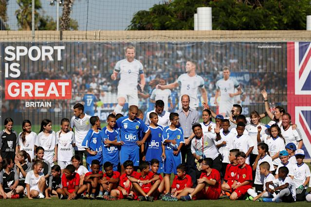 Britain's Prince William and Tomer Hemed, an Israeli professional footballer who plays as a striker for English Premier League club Brighton & Hove Albion, pose for a photo with Jewish, Muslim and Christian children during a soccer event organized by The Equalizer and Peres Center for Peace in Jaffa, near Tel Aviv, Israel, June 26, 2018. REUTERS/Amir Cohen