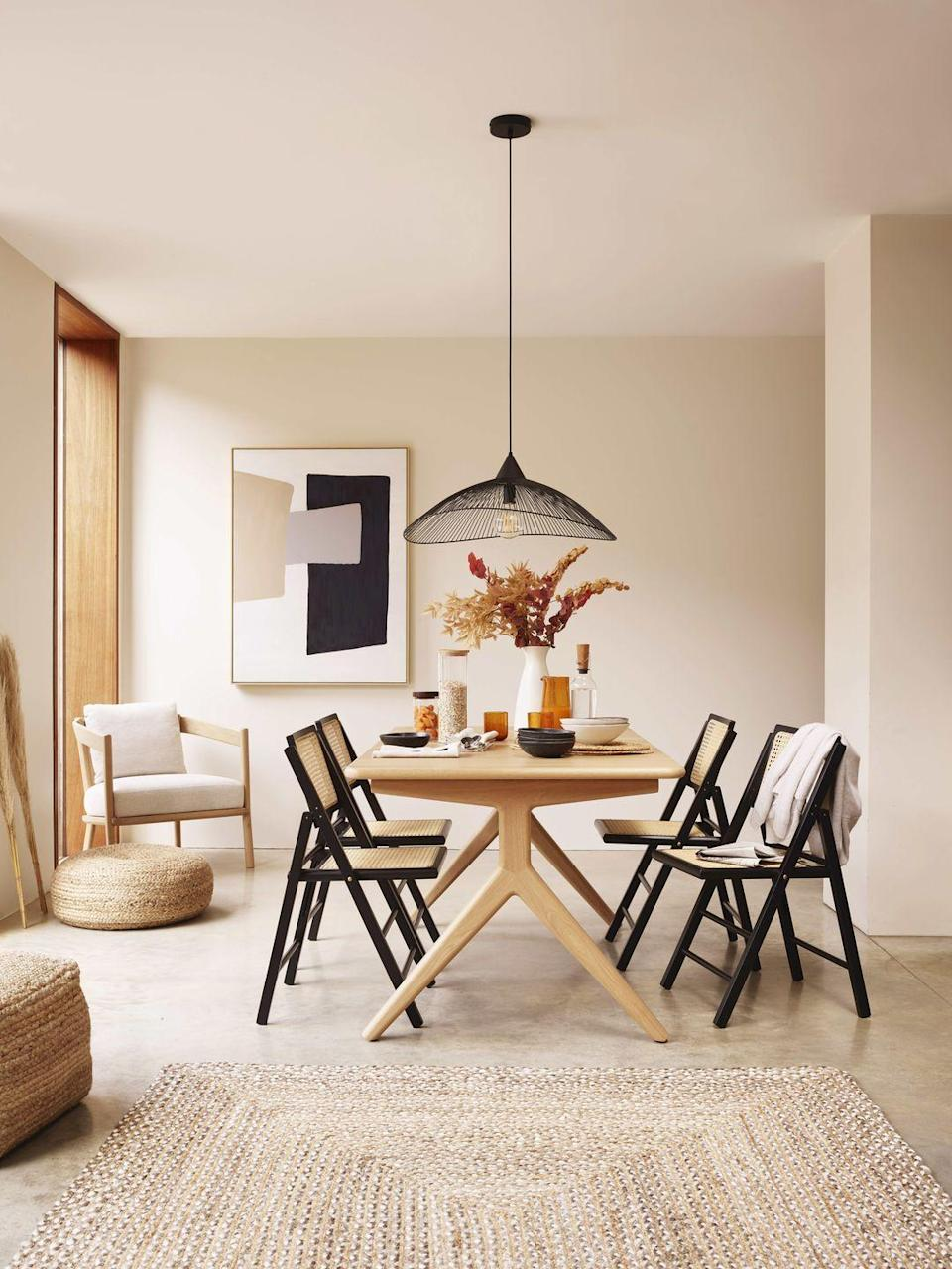 """<p>A hard-working design, 'Poise' can accommodate up to eight people thanks to the extendable panel that's stored within the table's frame. Made from solid oak, its splayed legs and refined lines give a subtle nod to Scandi style and create a timeless silhouette. Dining table, £999; chairs, £99 each; ceiling light, £175, all <a href=""""https://www.johnlewis.com/"""" rel=""""nofollow noopener"""" target=""""_blank"""" data-ylk=""""slk:johnlewis.com"""" class=""""link rapid-noclick-resp"""">johnlewis.com</a></p>"""