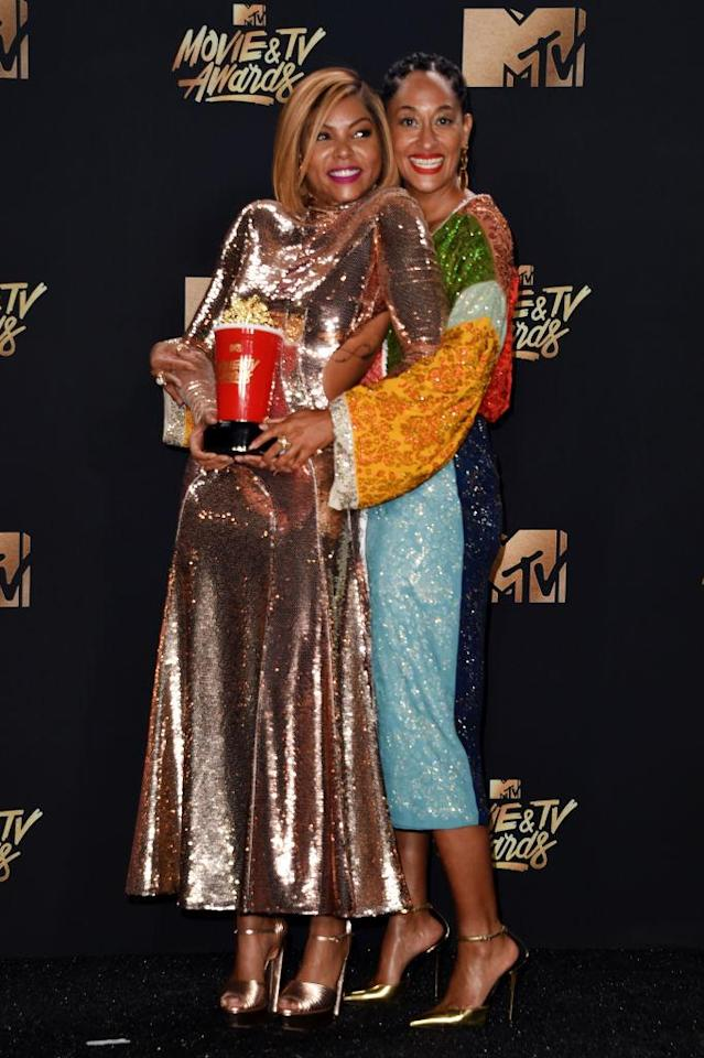 Taraji P. Henson and Tracee Ellis Ross pose in the press room during the 2017 MTV Movie and TV Awards. (Photo: Getty Images)