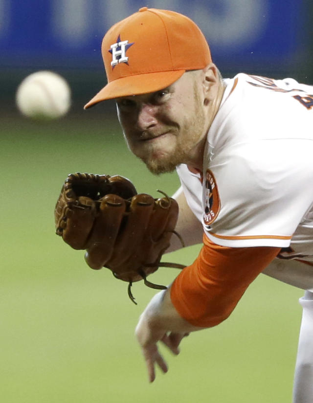 Houston Astros' Brett Oberholtzer delivers a pitch against the Boston Red Sox during the first inning of a baseball game Saturday, July 12, 2014, in Houston. (AP Photo/Pat Sullivan)