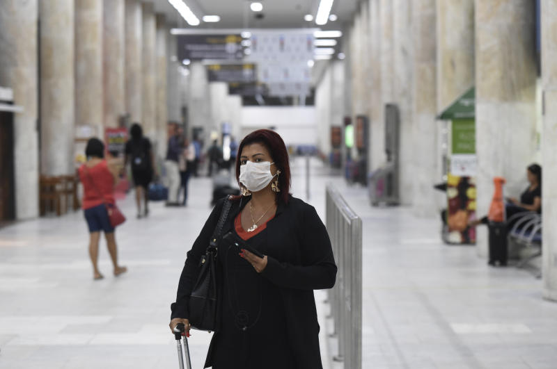 Passengers wearing surgical masks to protect against the corona virus at Santos Dumont airport, in Rio de Janeiro, Brazil, on March 17, 2020. (Photo by Fabio Teixeira/NurPhoto via Getty Images)