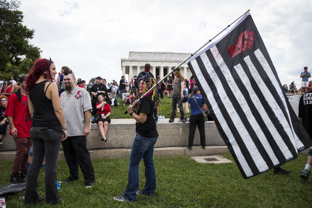 <p>People gather for a rally before the start of the Juggalo March, at the Lincoln Memorial on the National Mall, Sept. 16, 2017 in Washington. (Photo: Al Drago/Getty Images) </p>