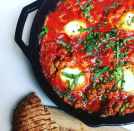 """<p>You've heard of Eggs in Purgatory. Now try Eggs in Hades from the <em><a href=""""https://www.amazon.com/Man-Pan-Plan-Delicious-Nutritious/dp/1635650046"""" rel=""""nofollow noopener"""" target=""""_blank"""" data-ylk=""""slk:A Man, A Pan, A Plan"""" class=""""link rapid-noclick-resp"""">A Man, A Pan, A Plan</a></em> cookbook. Spicy sausage and crushed red pepper flakes fire up the sauce-and-eggs feast. It's like John Carpenter got a hold of shashuka.</p><p>Here's <a href=""""https://www.menshealth.com/nutrition/a19538594/spicy-protein-egg-recipe/"""" rel=""""nofollow noopener"""" target=""""_blank"""" data-ylk=""""slk:the recipe video"""" class=""""link rapid-noclick-resp"""">the recipe video</a>.</p>"""