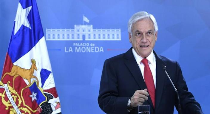 Chilean President Sebastian Pinera apologized in an address to the nation for failing to anticipate the outbreak of social unrest (AFP Photo/HO)
