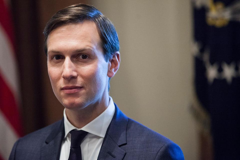 """Jared Kushner bragged about Donald Trump """"getting the country back from the doctors"""" in an April interview with journalist Bob Woodward, a report says. (Photo by Zach Gibson - Pool/Getty Images)"""