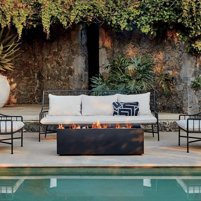 Focal points like this modern fire pit make for cozy, great-looking gathering places.