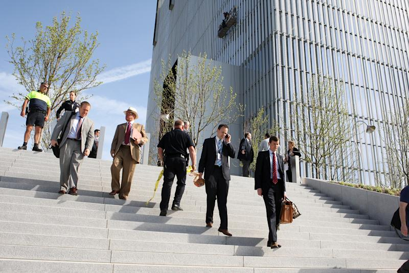 Federal Courthouse employees evacuate as police investigate a shooting inside the Federal Courthouse, Monday, April 21, 2014, in Salt Lake City. The shooting has left at least one person injured, a spokeswoman for the U.S. attorney said. (AP Photo/The Deseret News, Hugh Carey) SALT LAKE TRIBUNE OUT; MAGS OUT