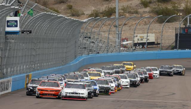 From left to right, Matt Kenseth (20), Brian Scott (2) and Brad Keselowski (22) lead the pack of racers at the start of a NASCAR Nationwide auto race Saturday, March 1, 2014, in Avondale, Ariz. (AP Photo/Ross D. Franklin)