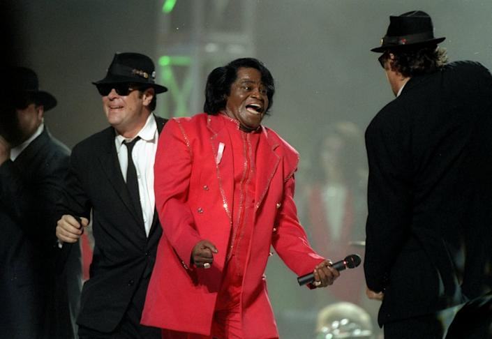 "<div class=""inline-image__caption""><p>Dan Aykroyd, James Brown, and James Belushi perform during the half-time show for Super Bowl XXXI between the New England Patriots and the Green Bay Packers at the Superdome in New Orleans, Louisiana, in 1997.</p></div> <div class=""inline-image__credit"">Doug Pensinger/Getty</div>"
