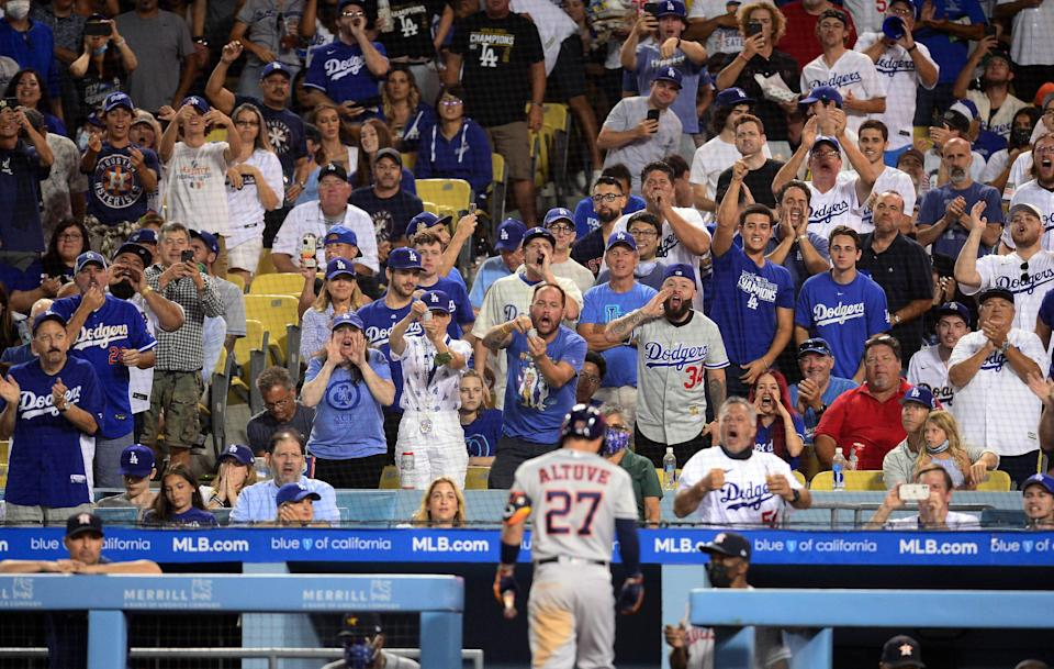 Dodger Stadium spectators react after the Houston Astros' Jose Altuve strikes out during the fifth inning.