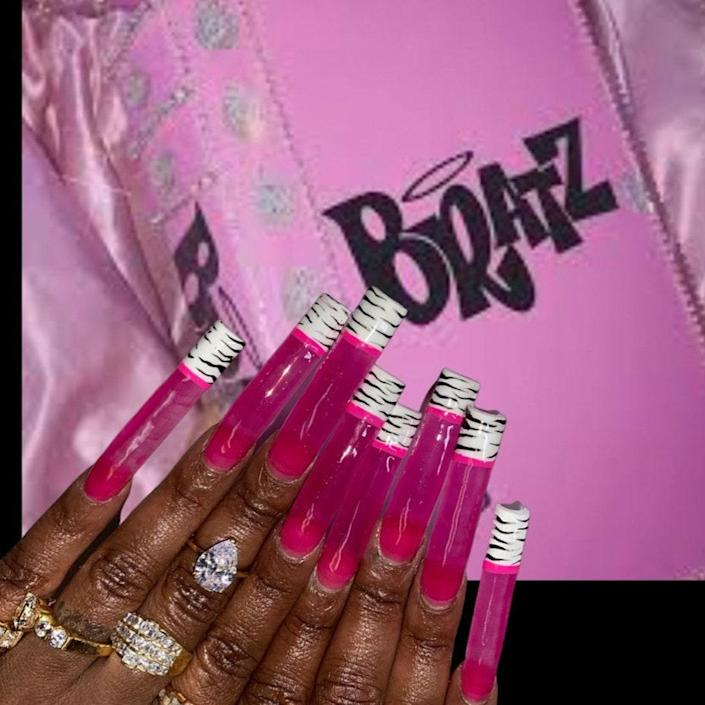 Jasmine created this hot-pink jelly manicure that's giving all the Y2K feels. The sheer neon hue transitions into zebra-print tips that look phenomenal. We especially love the solid-colored border between the sheer pink hue and animal print.