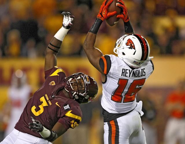 Oregon State cornerback Rashaad Reynolds (16) intercepts the ball in front of Arizona State wide receiver Richard Smith (3) during the first half of an NCAA college football game on Saturday, Nov. 16, 2013, in Tempe, Ariz. (AP Photo/Rick Scuteri)