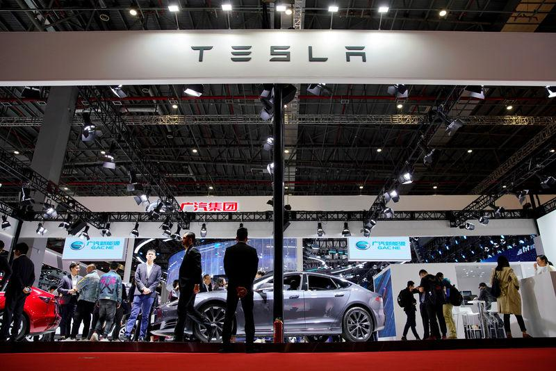 FILE PHOTO: Tesla stock and bonds tumble as investors fret about costs and safety