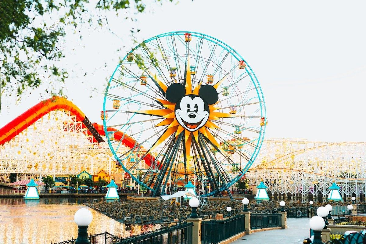 """Using the same method of calculations for Disney World, a trip to <a href=""""https://bestlifeonline.com/disneyland-champagne-princess/?utm_source=yahoo-news&utm_medium=feed&utm_campaign=yahoo-feed"""">Disneyland</a> in California will cost a family with two adults and two children approximately $3,369. The reason why it's so much less than Disney World? You only need about three days to tackle this smaller park.  For a family of four looking to stay in a standard room at Disneyland's <a href=""""https://disneyland.disney.go.com/hotels/paradise-pier-hotel/rates-rooms/"""" target=""""_blank"""">Paradise Pier Hotel</a>, the park's least expensive option, a three-night stay in June comes to $428 per night, or $1,284 in total. For <a href=""""https://disneyland.disney.go.com/tickets/"""" target=""""_blank"""">entry to the park</a> for two adults and two children under age 10, with the addition of the park hopper option, you'll spend at least $355 per adult and $335 per child—a grand total of $1,380 for the entire family.  According to <a href=""""https://mickeyvisit.com/disneyland-vacation-cost/"""" target=""""_blank"""">Mickey Visit</a>, a four-person family will also likely spend about $480 on food during their three days in the park—a price that goes up with the addition of special character dinners. And, just like at Disney World, guests can expect to spend around $75 per day on souvenirs and other extras (adding another $225).  In order to save money on your trip to Disneyland, be sure to book your hotels far in advance—and to perhaps consider visiting during the park's slower season between September and December."""