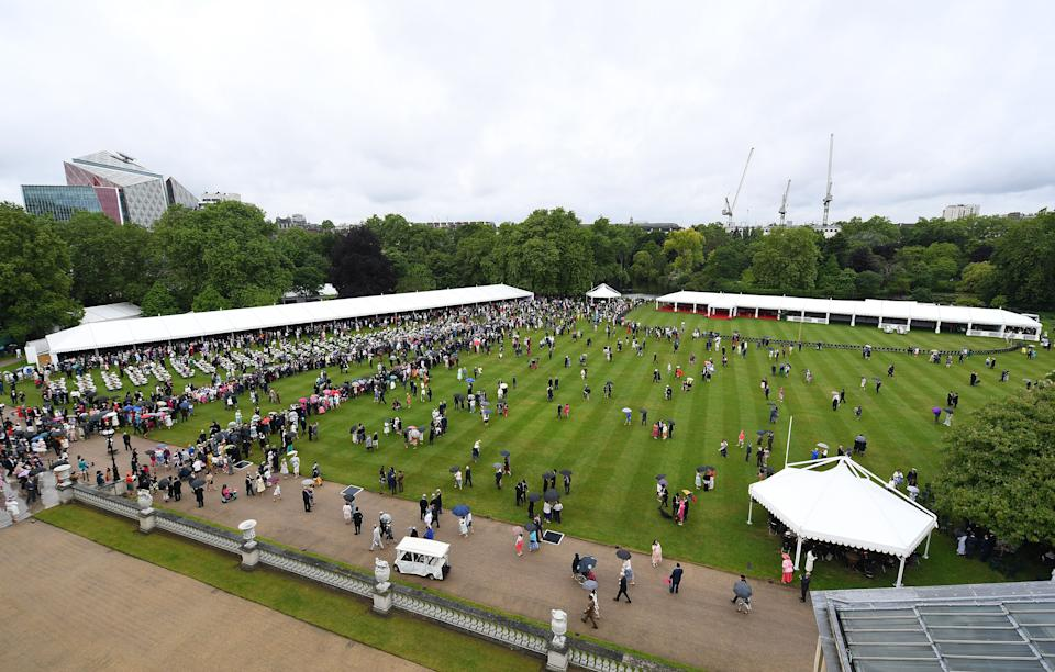 Guests gather on the lawn during the Queen's Garden Party at Buckingham Palace, central London on May 29, 2019. (Photo by Stuart C. Wilson / POOL / AFP)        (Photo credit should read STUART C. WILSON/AFP via Getty Images)