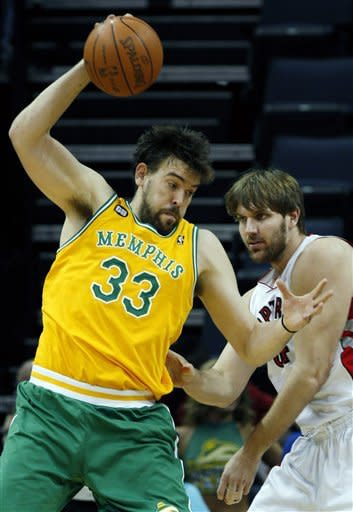 Memphis Grizzlies center Marc Gasol (33), of Spain, goes to the hoop as Toronto Raptors center Aaron Gray (34) defends in the first half of an NBA basketball game on Friday, March 16, 2012, in Memphis, Tenn. (AP Photo/Alan Spearman)