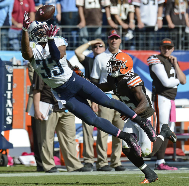 FILE - In this Oct. 5, 2014, file photo, Tennessee Titans safety Michael Griffin (33) intercepts a pass intended for Cleveland Browns wide receiver Andrew Hawkins (16) in the fourth quarter of an NFL football game, in Nashville, Tenn. Griffin started his NFL career as a first-round draft pick by the Tennessee Titans, and he signs a one-day contract to retire after nine seasons with the franchise where he played nine seasons.(AP Photo/Mark Zaleski, Fle)