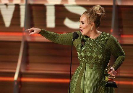 """Adele accepts the Grammy for Record of the Year for """"Hello"""" given to her and co-writer Greg Kurstin (not pictured) at the 59th Annual Grammy Awards in Los Angeles, California, U.S., February 12, 2017. REUTERS/Lucy Nicholson"""