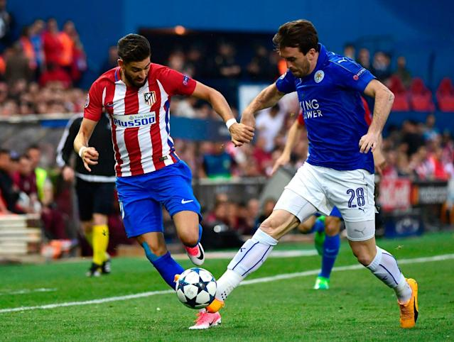 <span>Yannick Carrasco vies with Christian Fuchs</span> <span>Credit: AFP PHOTO / PIERRE-PHILIPPE MARCOU </span>