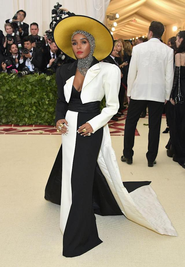 <p>Monae ensured that her Marc Jacobs dress worked within her black and white color scheme, but added a pop of color with a hat. (Photo: Getty Images) </p>