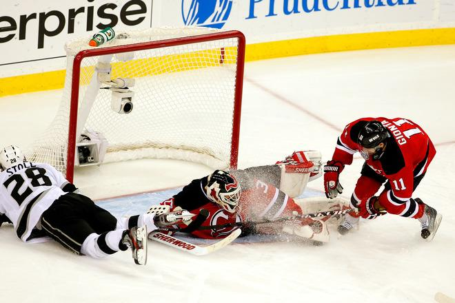 NEWARK, NJ - JUNE 09: Martin Brodeur #30 of the New Jersey Devils makes a save in front of Stephen Gionta #11 and Jarret Stoll #28 of the Los Angeles Kings during Game Five of the 2012 NHL Stanley Cup Final at the Prudential Center on June 9, 2012 in Newark, New Jersey.  (Photo by Paul Bereswill/Getty Images)